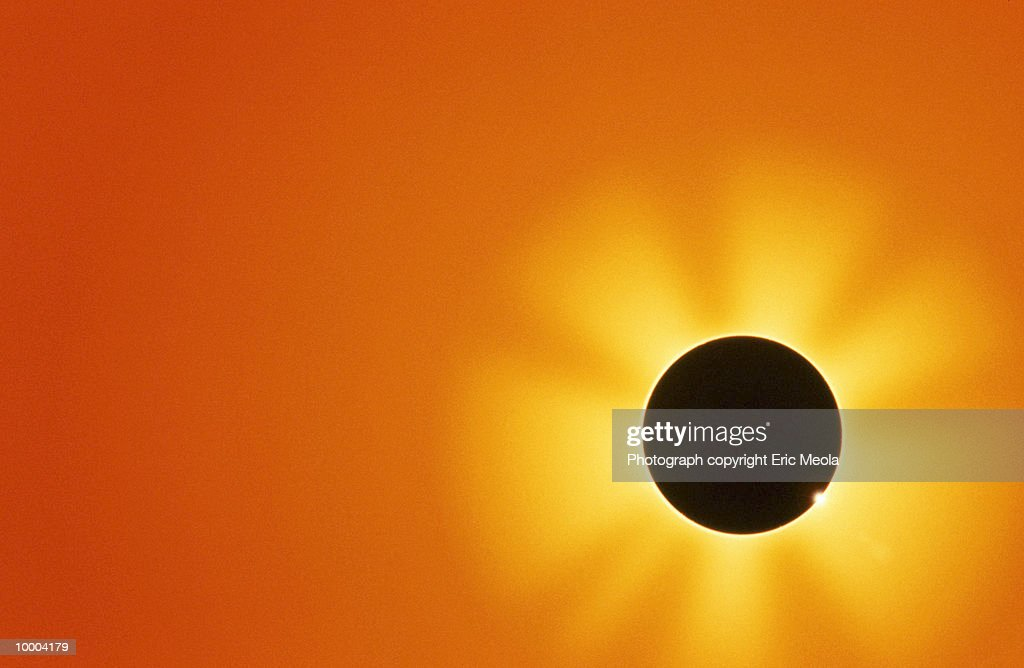 ECLIPSE EFFECT OF THE SUN SHINING : Stock Photo