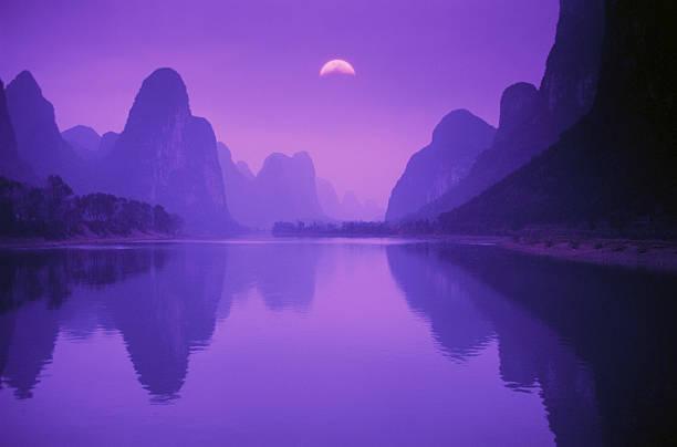 LI RIVER & MOUNTAINS AT DUSK IN GUILIN, CHINA