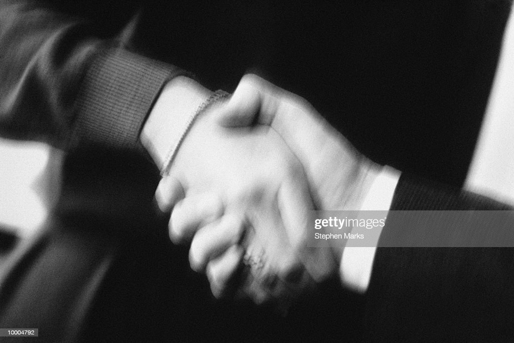 BUSINESSMEN'S HANDSHAKE BLUR AND BLACK AND WHITE : Stock Photo