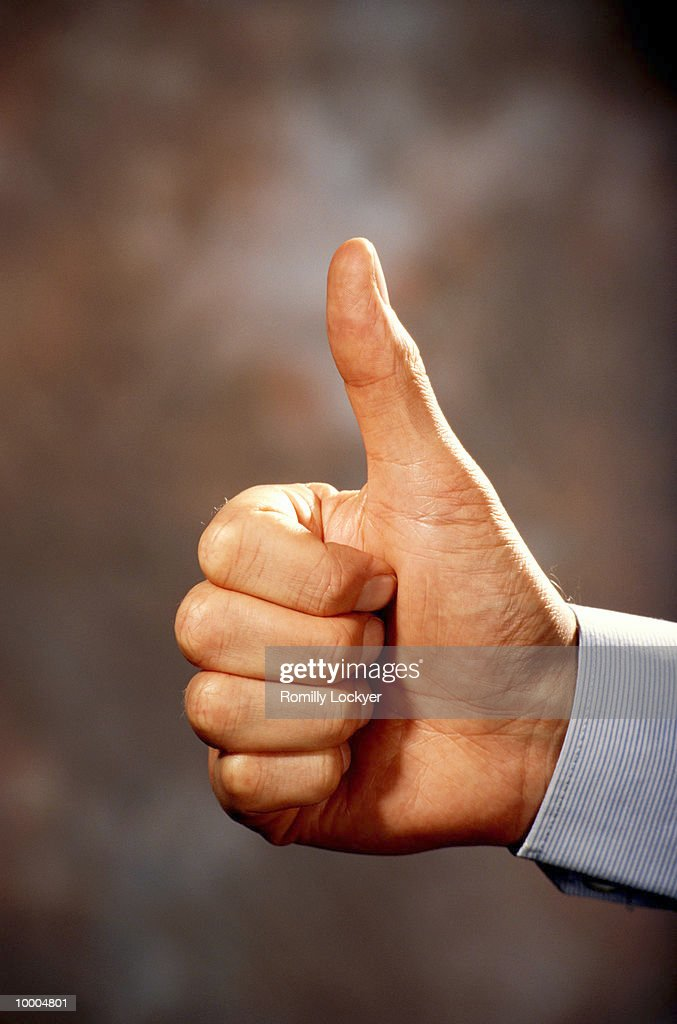 EXECUTIVE HAND WITH THUMBS UP SIGN : Stock Photo