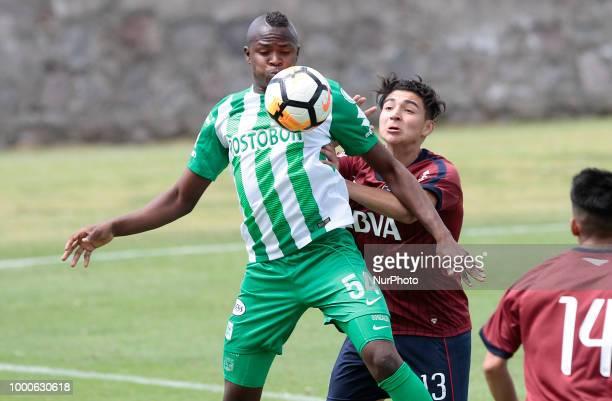 Andrés Caicedo of Atletico Nacional in action with Daniel Barrio Nuevo of Taller de Córdova Soccer International Cup Atlético Nacional vs Talleres de...