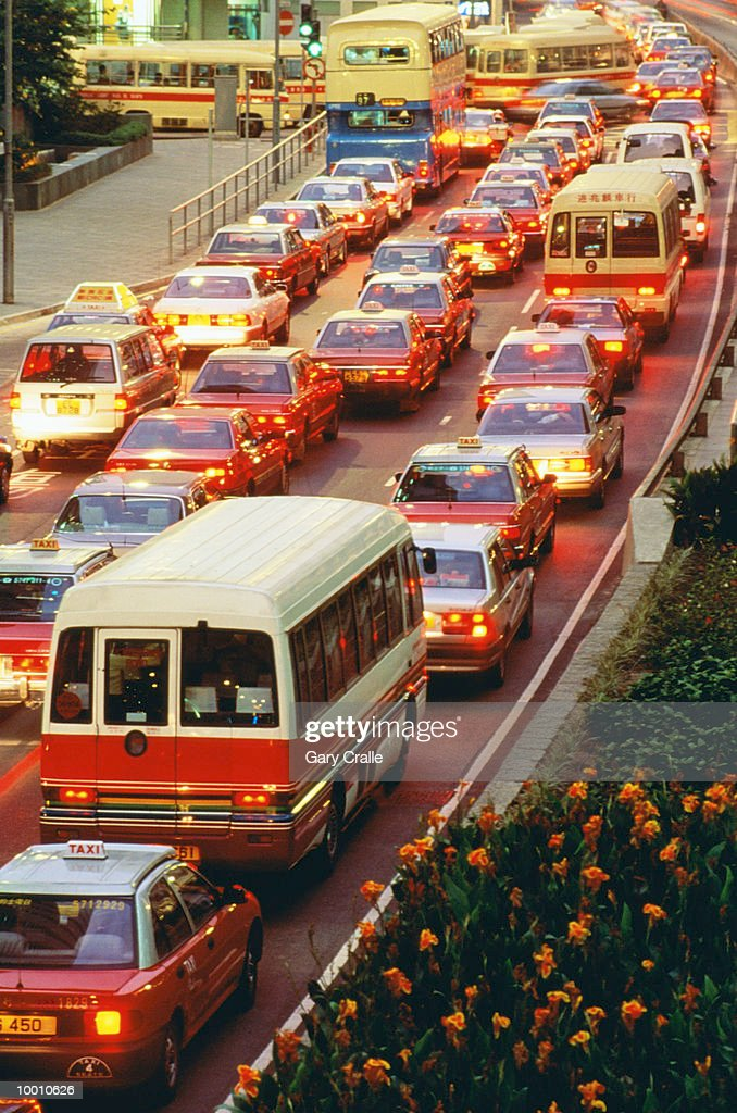 RUSH HOUR TRAFFIC AT DUSK IN HONG KONG : Stock Photo