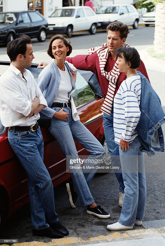 COUPLES TALKING BY CAR : Stock Photo