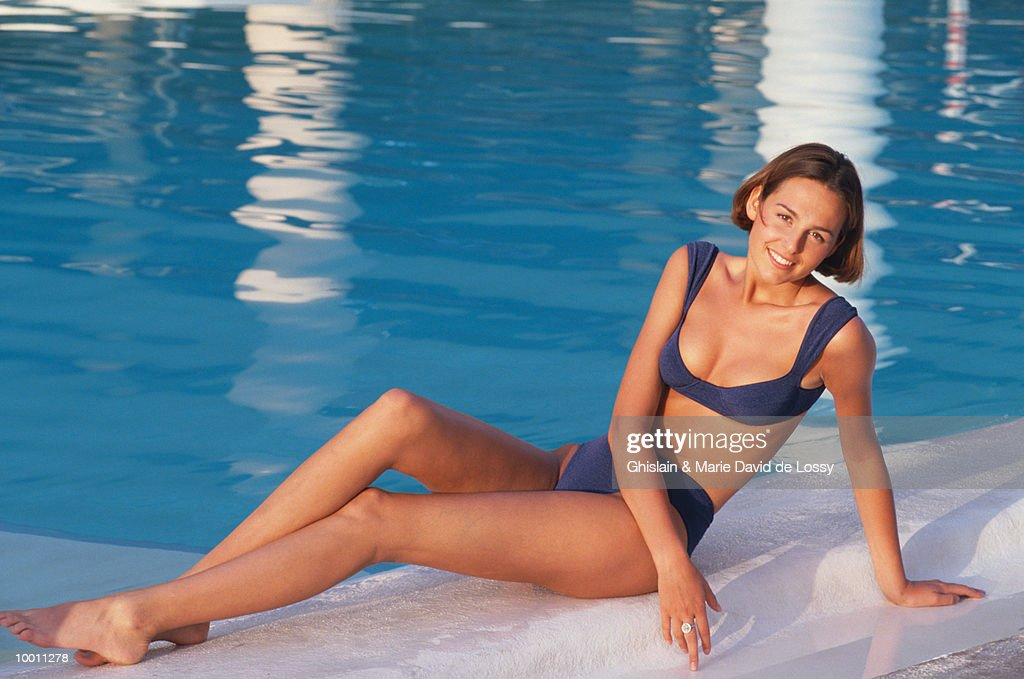 WOMAN IN BIKINI BY POOL : Stock Photo