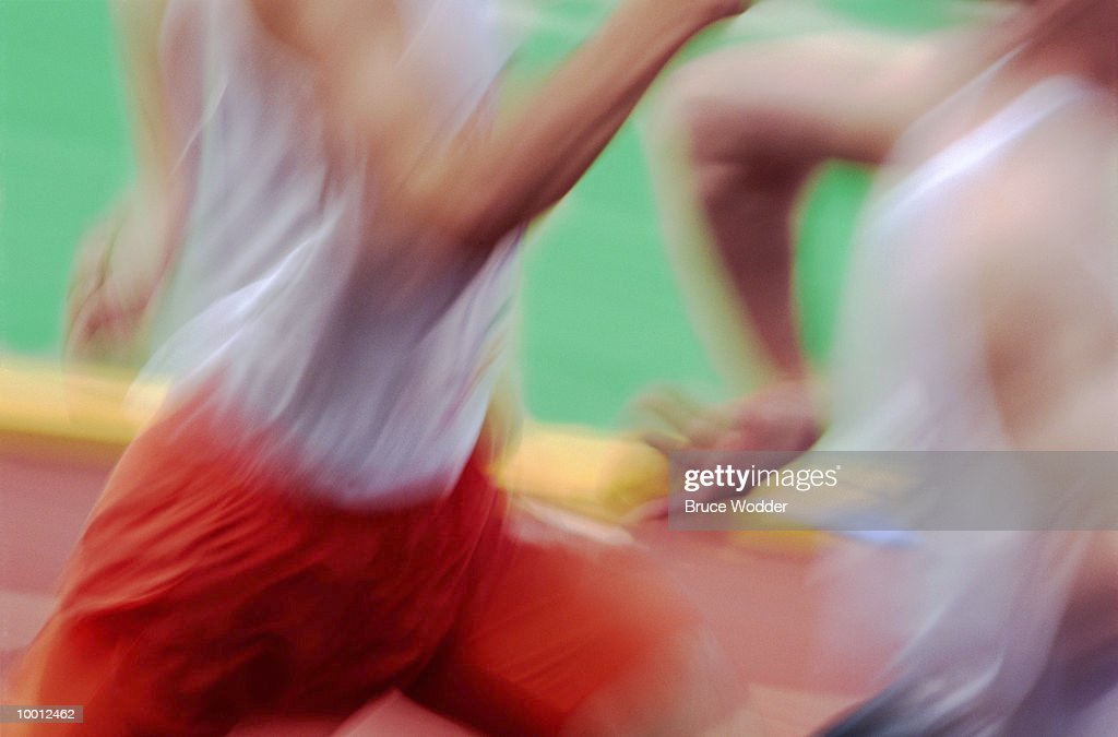 CLOSE-UP OF TRACK RUNNERS IN BLUR : Stock Photo