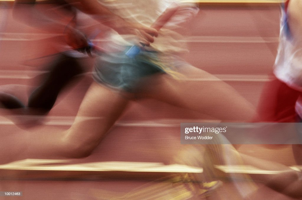 RELAY RUNNERS IN BLUR AND DETAIL : Stock Photo