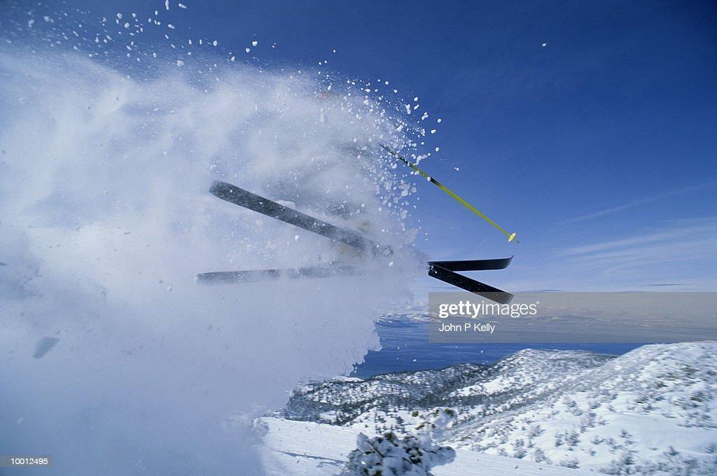 SKIER KICKING UP SNOW IN MIDAIR : Stock Photo