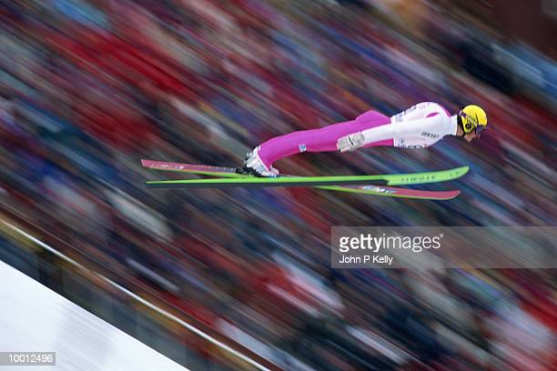 ski jumper in midair - ski jumping stock pictures, royalty-free photos & images