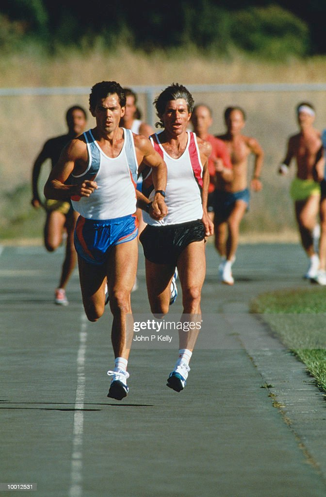 MEN IN TRACK RACE : Stock Photo
