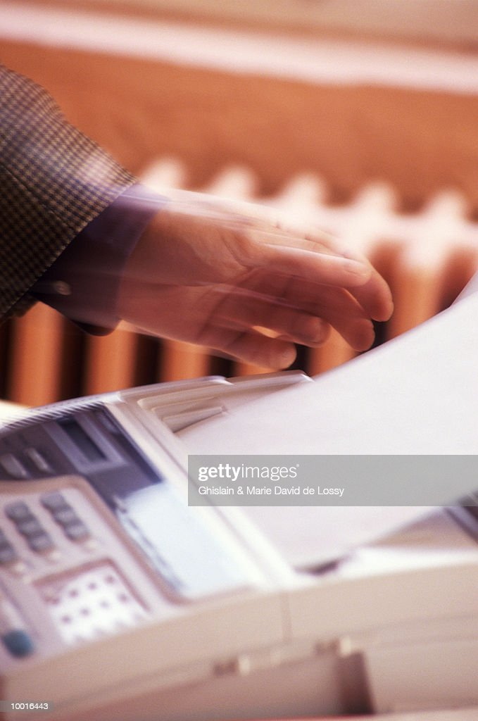 RECEIVING INFORMATION FROM A FAX MACHINE : Stock Photo