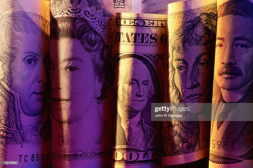 FOLDED INTERNATIONAL BANKNOTES : Stock Photo