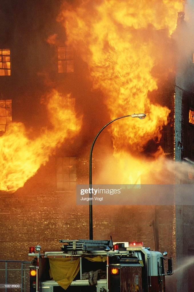 FIRE TRUCK BY BURNING BUILDING IN VANCOUVER, BRITISH COLUMBIA : Stock Photo