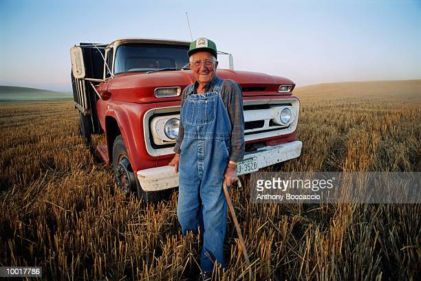 elderly farmer with cane and truck in field in washington - old truck stock pictures, royalty-free photos & images