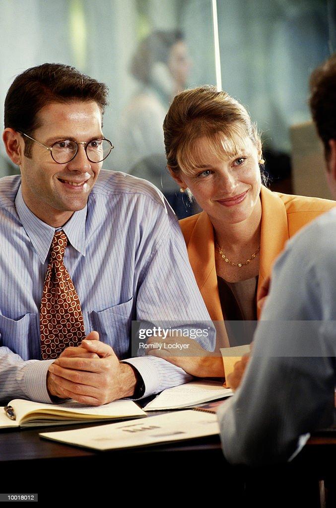 COUPLE MEETING WITH ADVISOR : Stock Photo