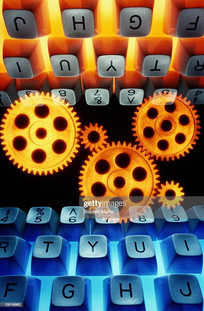 GEARS BETWEEN TWO KEYBOARDS : Stockfoto