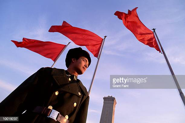 guard at tiananmen square in beijing, china - tiananmen square stock pictures, royalty-free photos & images