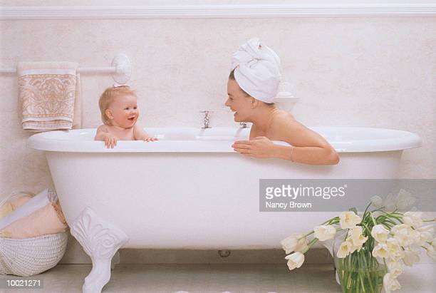 MOTHER & BABY IN ANTIQUE BATHTUB