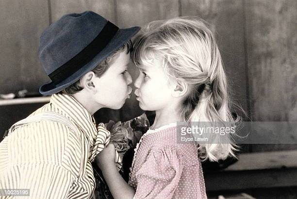Little boy and girl kiss stock photos and pictures getty images little girl boy sweethearts kissing altavistaventures Images
