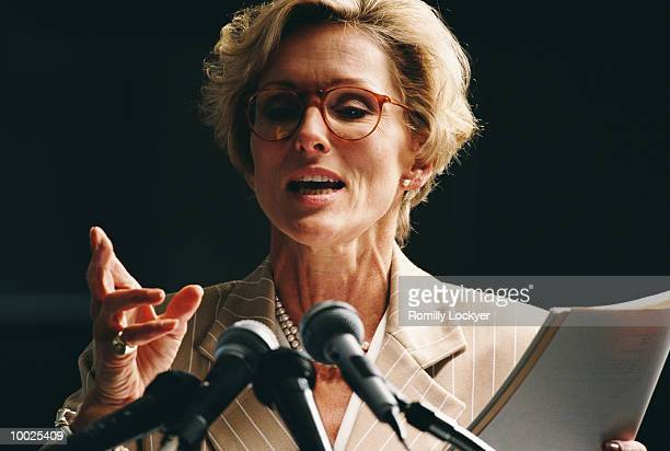 female conference speaker - speaker_(politics) stock pictures, royalty-free photos & images