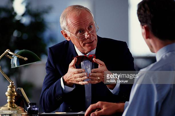 MAN MEETING WITH  LAWYER OR LEGAL ADVISOR
