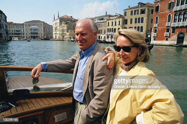 couple in water taxi on grand canal,venice - nationell sevärdhet bildbanksfoton och bilder