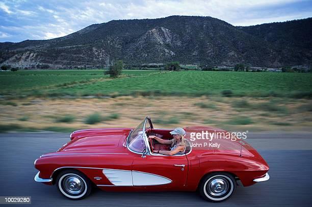 WOMAN DRIVING CORVETTE,  WESTERN COLORADO