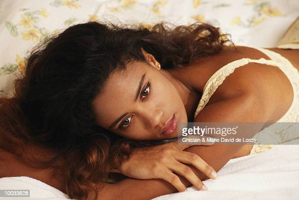woman lying on bed - bras stock pictures, royalty-free photos & images