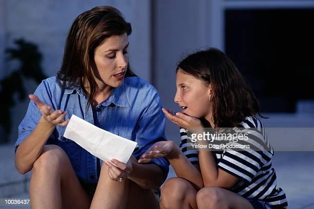 mom & daughter going over report card - boletim escolar imagens e fotografias de stock