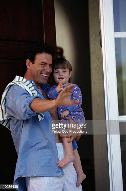 DAD & SON WAVING BYE TO MOM AT DOOR