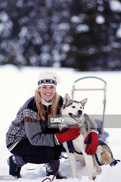 WOMAN WITH  HUSKY AND SLED IN LAKE TAHOE, CALIFORNIA