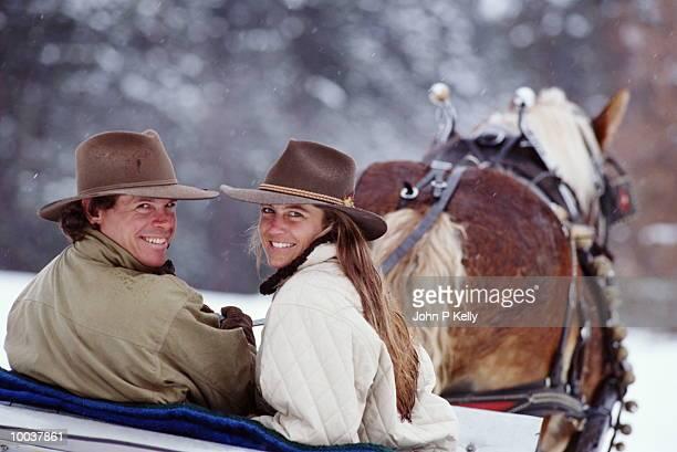 COUPLE IN HORSE DRAWN SLEIGH, CALIFORNIA