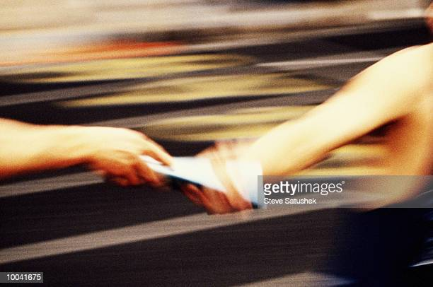 baton handoff in grainy effect - passing sport stock pictures, royalty-free photos & images
