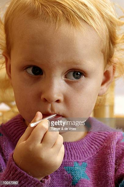 3 year old girl with thermometer - turner syndrome bildbanksfoton och bilder