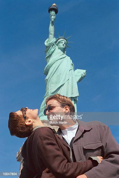 TOURING COUPLE AT STATUE OF LIBERTY