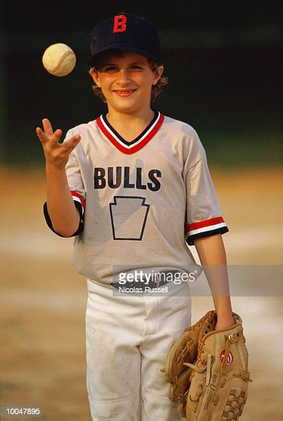 LITTLE LEAGUER 8 YEAR OLD WITH BASEBALL