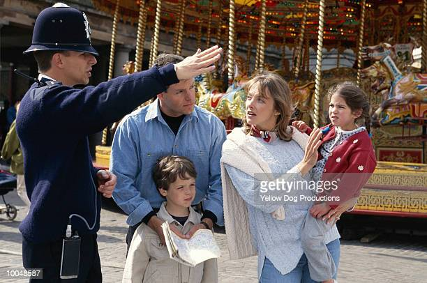 family with policeman in covent garden, england - northern european stock pictures, royalty-free photos & images
