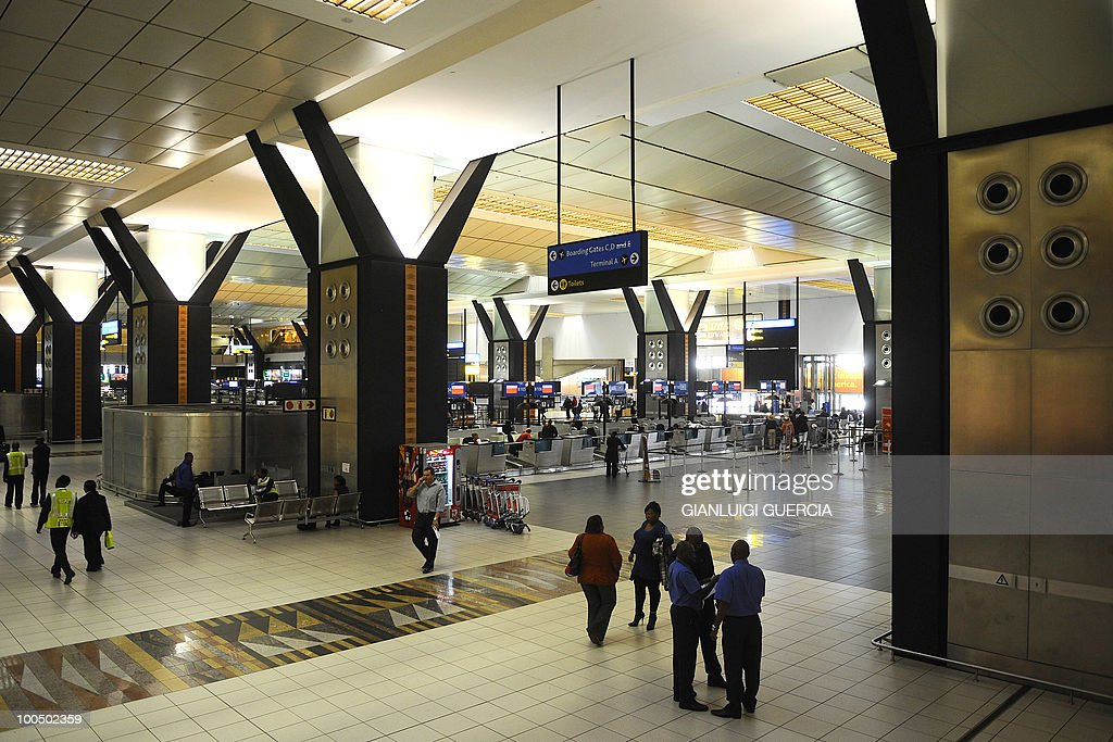People walk past check in counters at the O.R. Tambo international airport on May 25, 2010 in Johannesburg, South Africa. South Africa will host the Federation International Football Association (FIFA) soccer World Cup June 11- July 11, 2010.