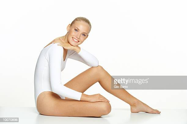 young woman in body suit, smiling - leotard stock pictures, royalty-free photos & images