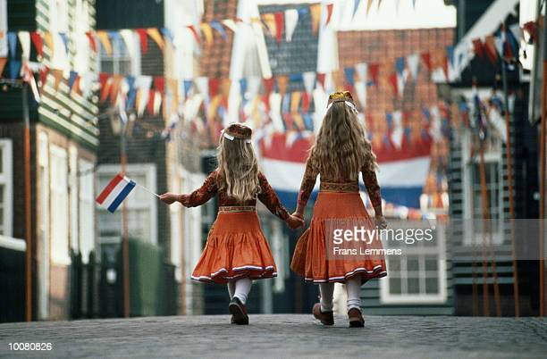 QUEENSDAY WITH GIRLS IN ORANGE DRESS IN HOLLAND