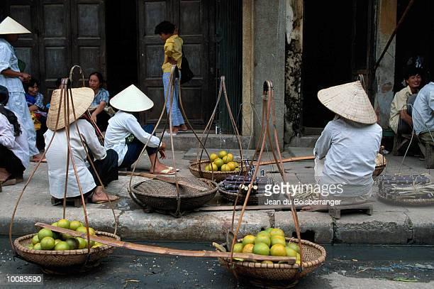 WOMEN IN MARKET IN HANOI, NORTH VIETNAM