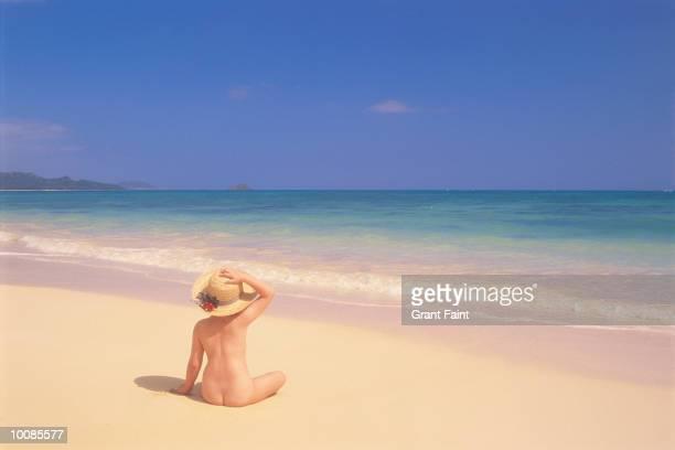 GIRL ON BEACH IN HAWAII, USA