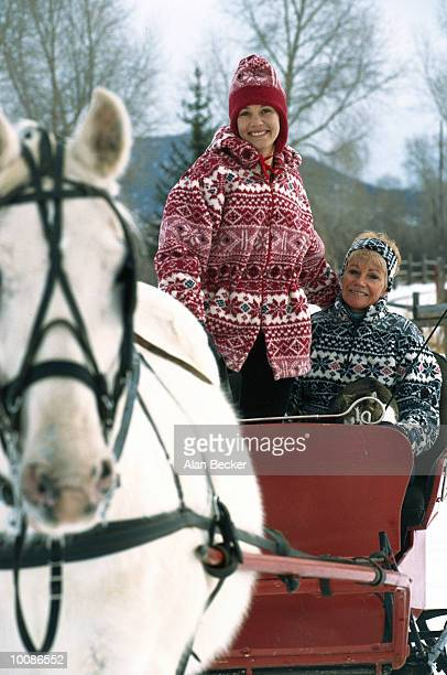 MOTHER AND DAUGHTER IN HORSE DRAWN SLEIGH
