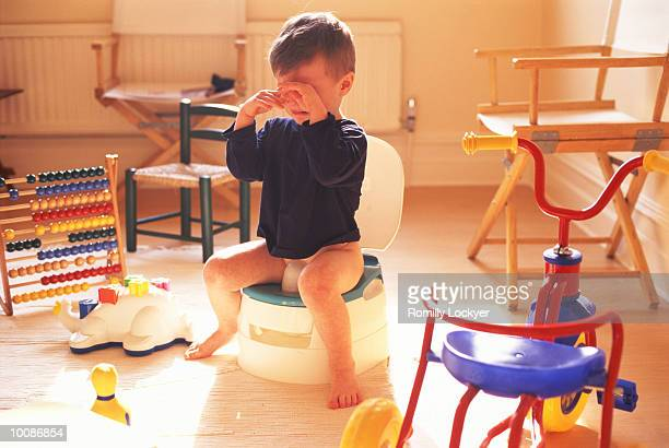 unhappy boy on the potty - urinating stock pictures, royalty-free photos & images