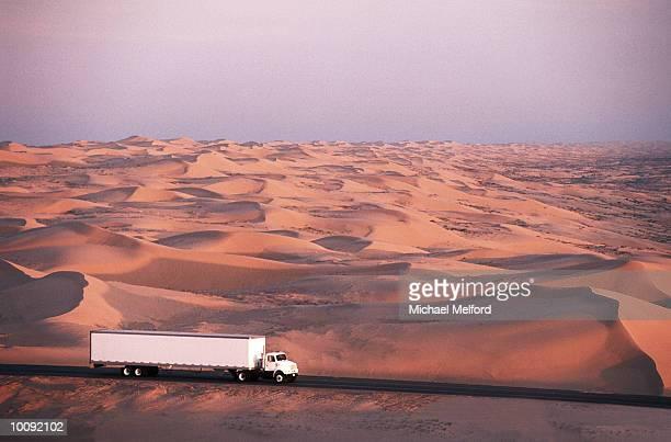 TRUCK CROSSING DESERT