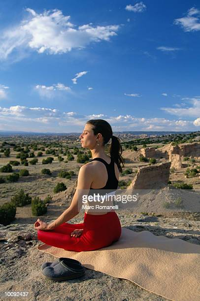 YOUNG WOMAN DOING  YOGA IN CHIMAYO, NEW MEXICO