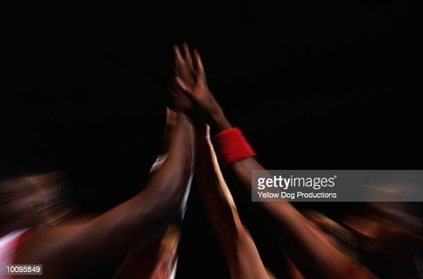 BASKETBALL PLAYERS DOING HIGH FIVES