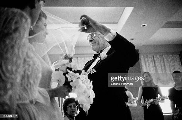 FATHER LIFTING VEIL- DAUGHTERS WEDDING