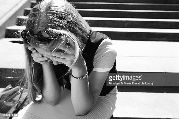FRUSTRATED FEMALE STUDENT ON STEPS