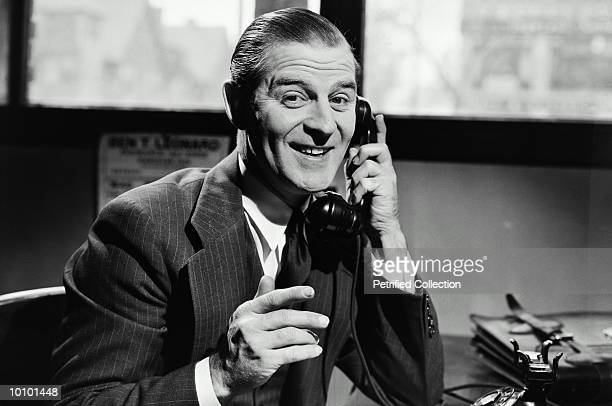 SMILING MAN ON TELEPHONE CIRCA 1940