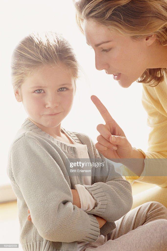 MOTHER DISCIPLINING DAUGHTER : Stock-Foto